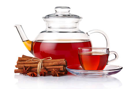 Glass teapot and cup of tea with spices isolated on white background Stock Photo - 13409915