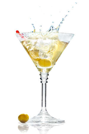 Olive splashing on martini glass isolated on white background