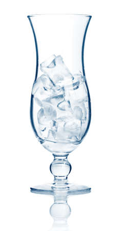 highball: Highball cocktail glass full of ice cubes isolated on white background