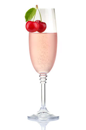 Glass of pink champagne with fresh cherry berries isolated on white background photo