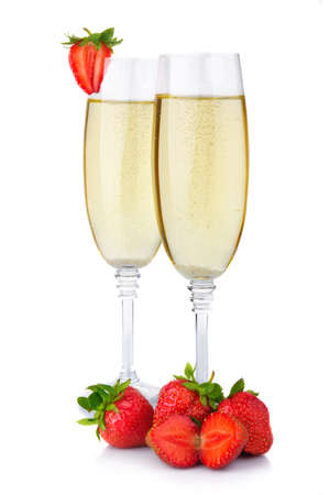 Two glasses of champagne and fresh strawberry isolated on white background