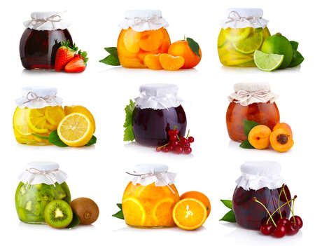 canned fruit: Set of glass jars with exotic fruits jam isolated on white