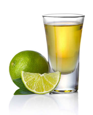 Gold tequila shot with lime isolated on white background Stock Photo