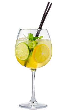 Alcohol cocktail with fresh mint and fruits isolated on white background photo