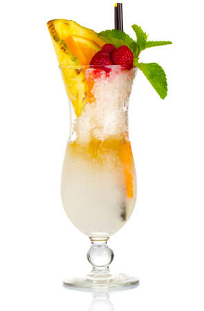 Alcohol cocktail with fruit slices, berries and mint isolated on white photo