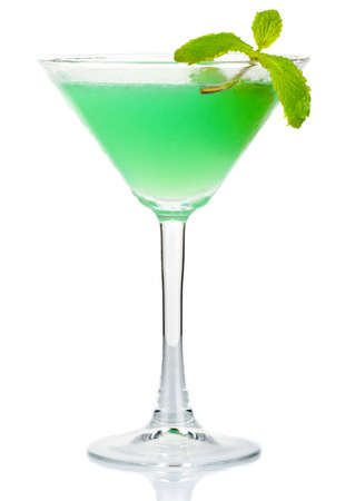 Green alcohol cocktail with fresh mint leaves isolated on white background photo