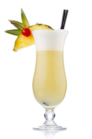 Yellow milk cocktail with berries and pineapple slice isolated on white Stock Photo