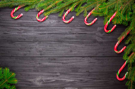 liquorice: Christmas fir tree on black wooden grunge background