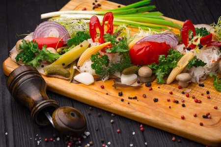 Set of pickled vegetables on black wooden background Stock Photo