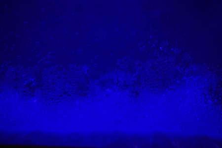 foamy: Foamy bubbles against a dark blue fluorescent background