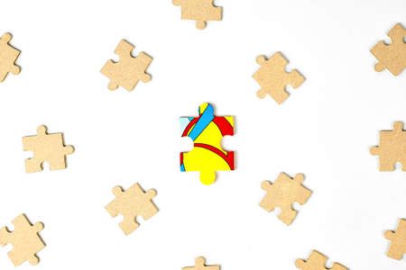 many puzzle pieces aim for a big puzzle as a leader symbol, on a white background, using both important things to combine or work together to succeed or solve a problem isolated