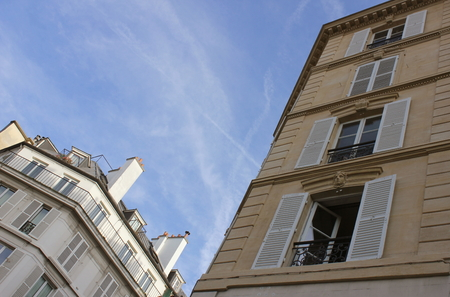 pres: View from the street on the French houses. Windows opened and closed, houses in France. Stock Photo