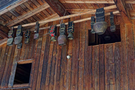 mount price: cowbell hanging under a roof