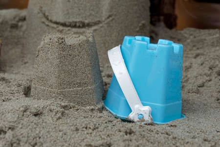 sandcastle: sandcastle with a blue toy bucket