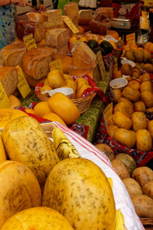 sorts: different sorts of cheese on a market