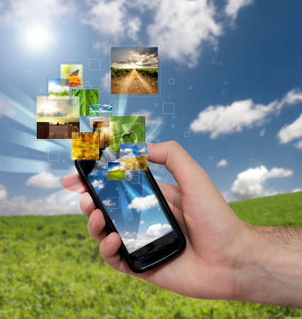Touch screen mobile phone with streaming images Stock Photo - 7574733