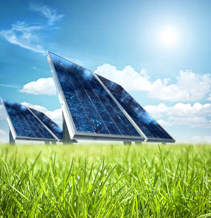 solar equipment: Solar panel in the green Stock Photo