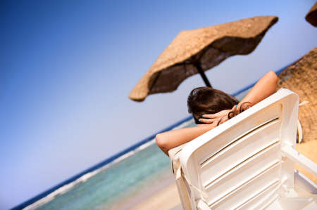 marsa: Girl relaxing in the blue beach of Marsa Alam Stock Photo