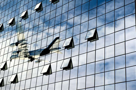Modern airport with airplane reflection photo