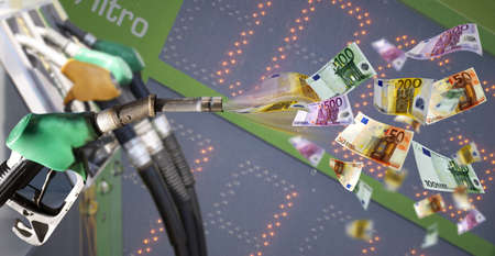Fuel pump with euro banknote against price billboard photo