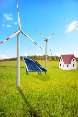 Alternative energy in a green field photo