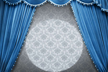 Vintage stage with blue curtain photo