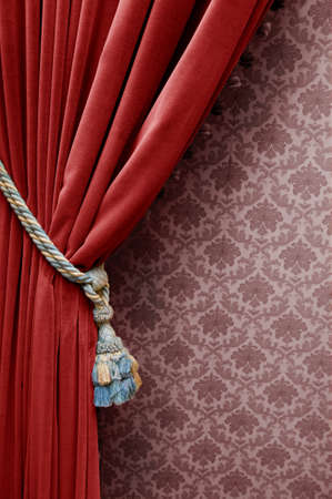 curtain background: Vintage red curtain on a floral wallpaper
