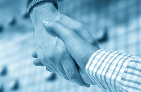 Handshake of businessman against office Stock Photo - 9099863
