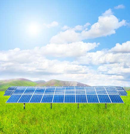 Solar panel in a green field photo