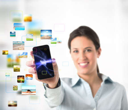 ringtones: Business girl with streaming mobile phone Stock Photo