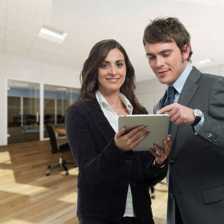 Business team looking pad in office Stock Photo - 9367366