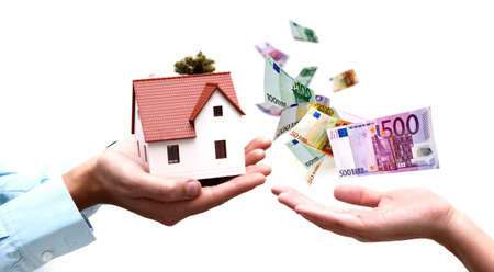 house exchange: Two hands exchange money with house Stock Photo