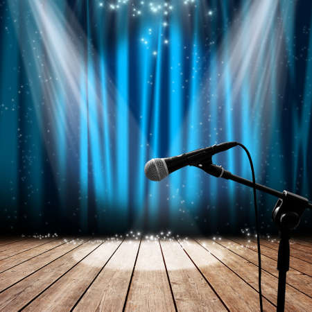 blue curtain: Blue stage with microphone and spotlight
