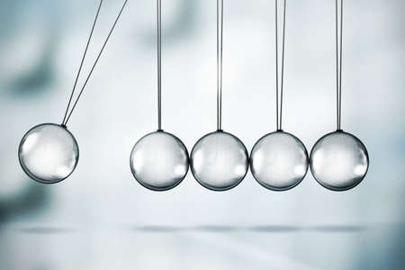 motion: Shiny Newtons cradle illustration Stock Photo