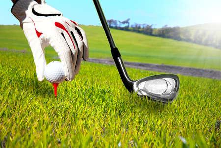 Golfer in a green field photo