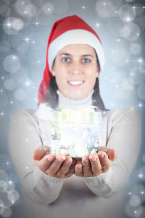 Glowing Christmas present with beautiful girl Stock Photo - 11309935