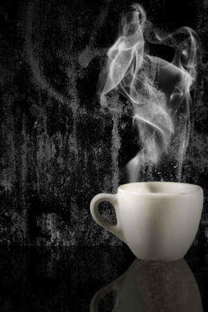 steaming coffee: closeup of a cup of steaming coffee