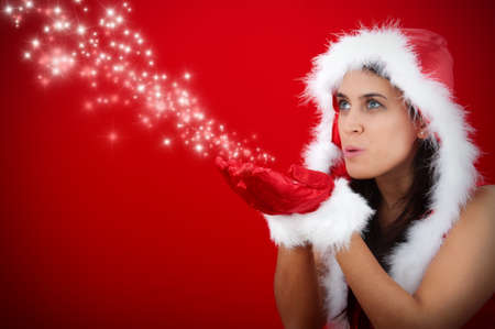 Christmas girl blowing magic stars photo