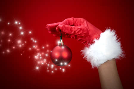 Hand holding magic Christmas ball Stock Photo - 11540036