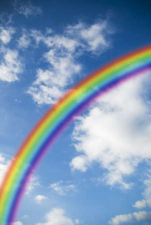 colorful rainbow on a sky background photo