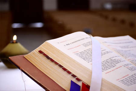 commandment: Bible and candle in a church Stock Photo