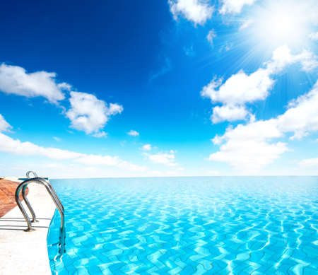 Infinite swimming pool with sun ray