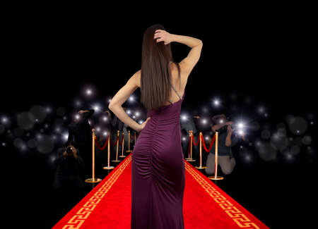 Celebrity on red carpet with photographer Stock Photo - 12322470