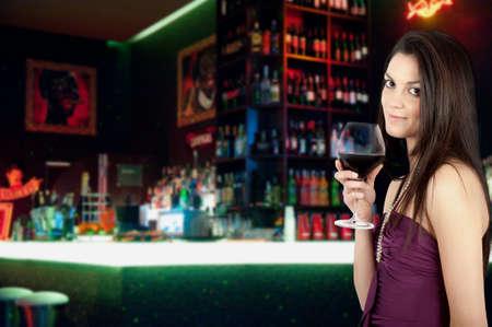 Attractive girl drinking wine Stock Photo - 12322476