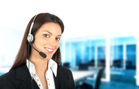 Smiling girl works in a call center photo