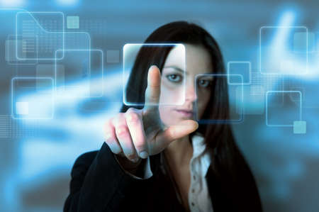 Businessgirl with a virtual touchscreen interface Stock Photo - 12322537