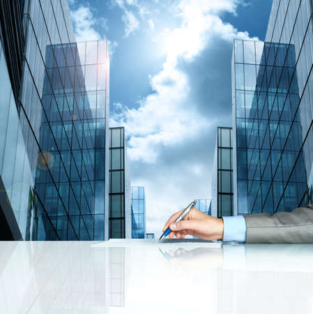 legal contract: Businessman signing contract against modern offices