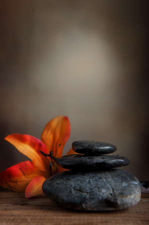 Spa stone with orange flower photo