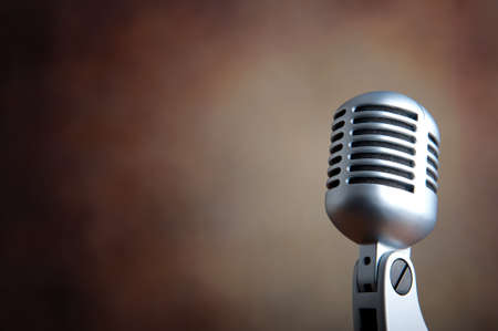 radio microphone: Old microphone against grunge background Stock Photo