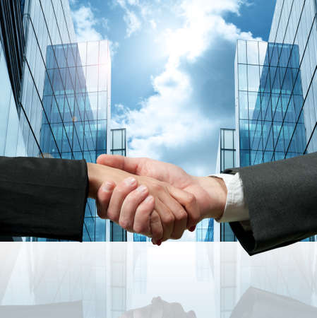 Business handshake in front of a modern city Stock Photo - 13196911